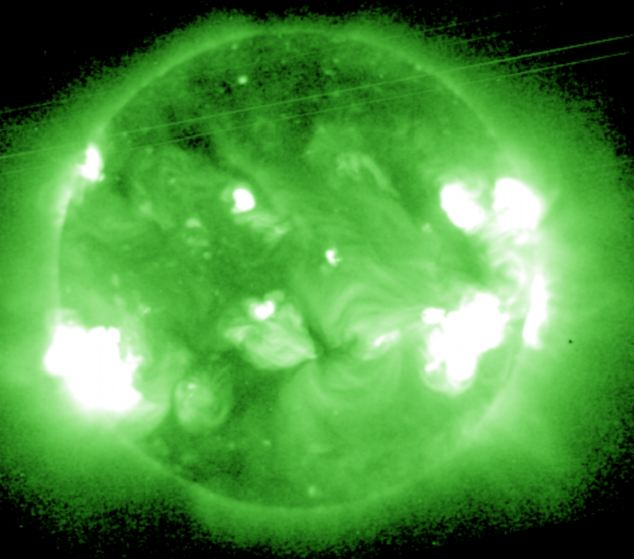 But the flares also released a 'coronal mass ejection', a huge cloud of irradiated particles and a magnetic shockwave which could hit Earth on Friday, potentially knocking out mobile phone satellites and GPS
