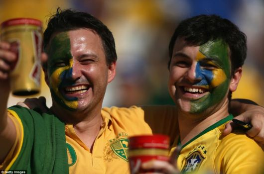 Brazil fans enjoy the atmosphere - and a beer - during the opening ceremony of the 2014 FIFA World Cup in Brazil