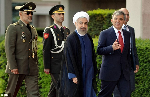 Iranian President Hassan Rouhani, pictured here on Monday in Turkey with Turkish President Abdulah Gul, promised 'constructive engagement' with the world when he was elected. Tehran is open to the possibility of working with the United States to support Baghdad, a senior Iranian official said today