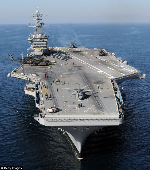 Firepower: The Nimitz-class aircraft carrier USS Carl Vinson is stationed in the Persian Gulf and can be called on to launch fighter jet sorties to the north