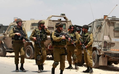 Israeli soldiers deploy near the West Bank city of Hebron on Friday. Israeli soldiers searched the West Bank on Friday for three missing teenagers from nearby settlements, one of them a U.S. citizen, amid fears Palestinian militants abducted them, authorities said