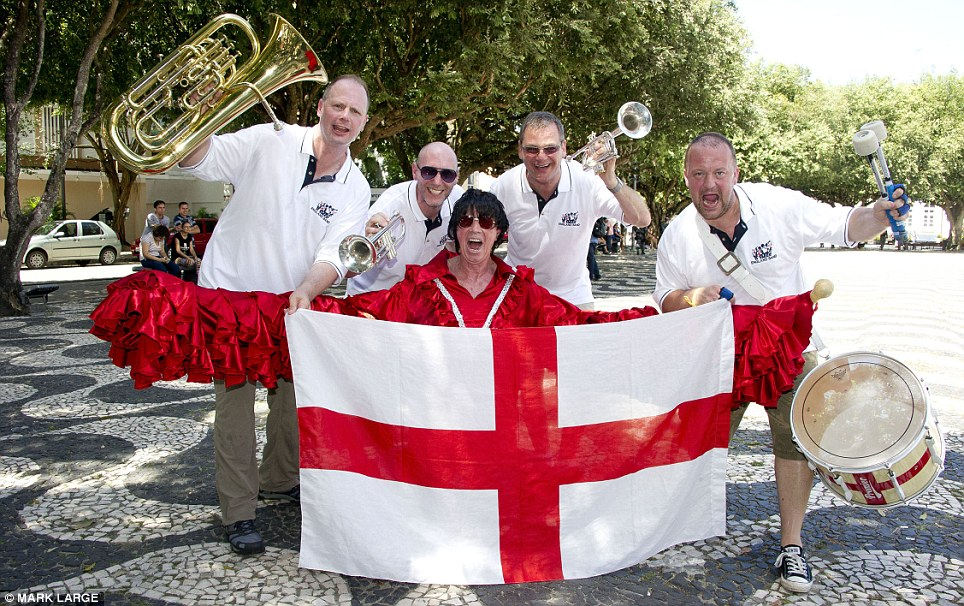 Bold as brass: The England band (from left: Ken Barlow, Lawrence Geraghty, John Hemmingham, Stuart Holmes and Bernard Clifton, front) have also arrived in Brazil