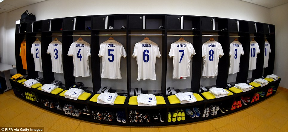 Three lions on a shirt: The England kit hangs ready in the dressing rooms of the Arena Amazonia - hours before being worn by Gerrard, Lampard, Wilshere et al