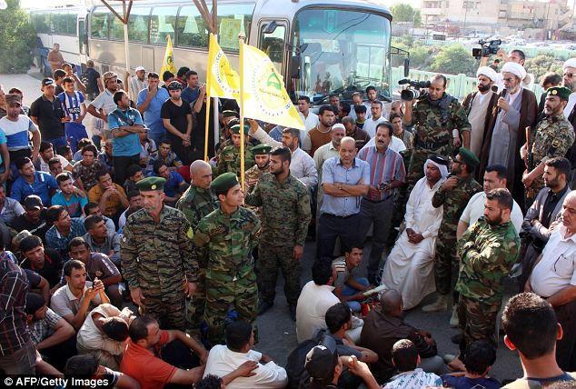 Les hommes répondaient à un appel lancé par le grand ayatollah Ali al-Sistani pour les Irakiens à défendre leur pays