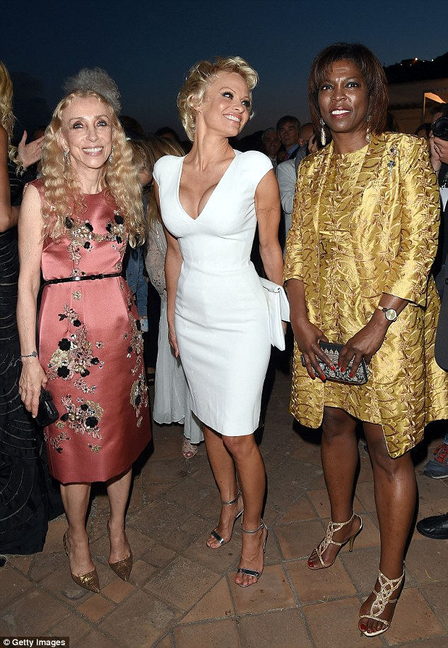 Powerful women: She flashed a smile alongside Italian Vogue Editor-In-Chief Franca Sozzani, and Executive Director of the United Nations World Food Programme, Ertharin Cousin