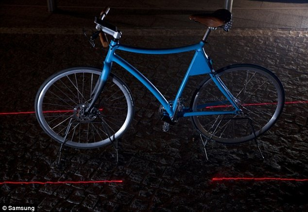 lasers projects a virtual lane on to the road to make sure motorists keep a safe distance away from the bike