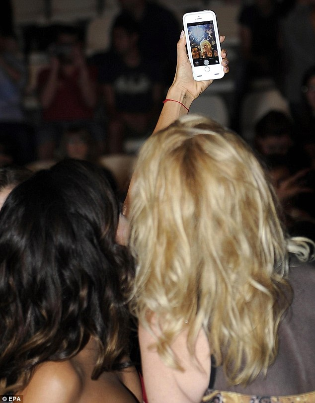 Let's selfie ourselves: The brunette held out her iPhone as the blonde smiled in a BFF worthy shot