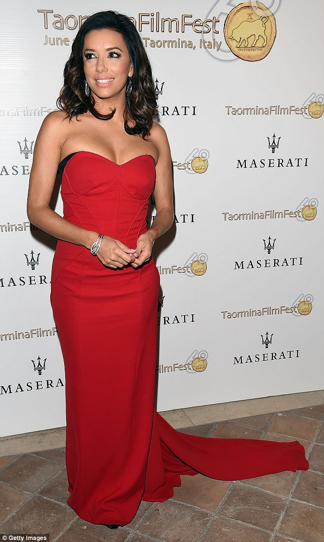 Sweeping statement: Eva chanelled old Hollywood in a floor length red dress which accentuated her petite frame