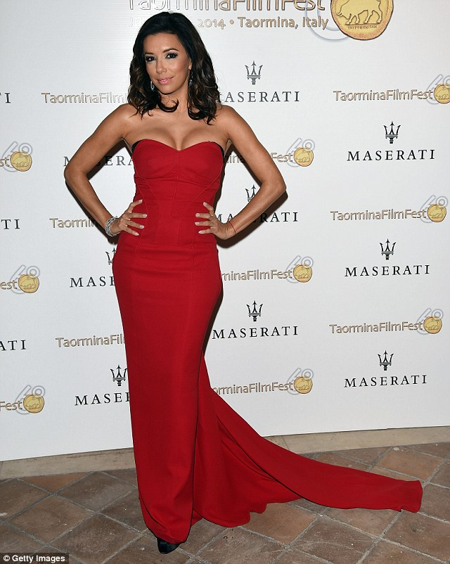 Dressed to impress: Eva turned out in a floor length red dress to collect her award