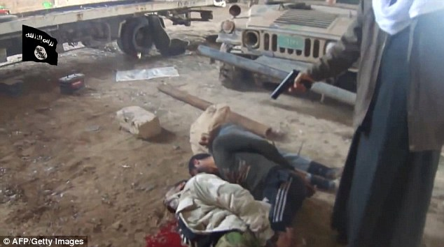 Brutal: A video uploaded to Youtube appears to shows ISIS militants executing a group of Iraqi soldiers at an undisclosed location in Anbar province