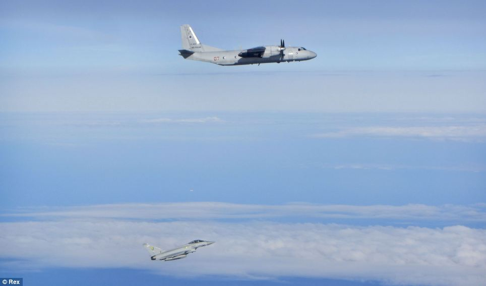 The Antonov An26 Curl transport aircraft is followed by a RAF Typhoon. The scramble came as the Ukrainian president announced a plan to end fighting in eastern Ukraine