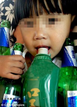 Habit: Doctors and social services are meeting to discuss the child's future as his parents insist they cannot do anything to ween him off alcohol