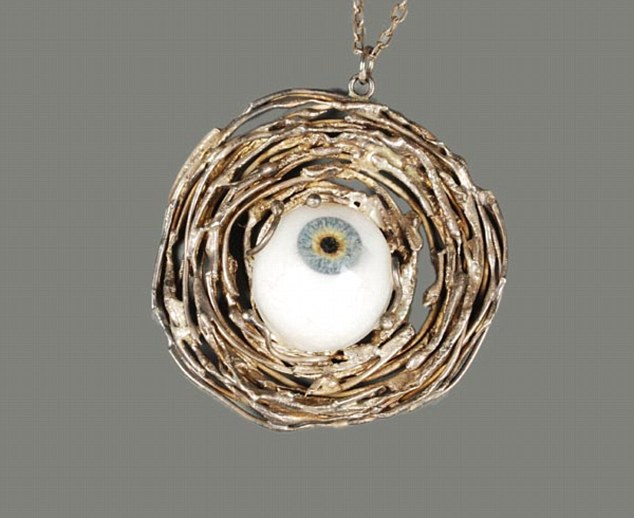 Auction: This necklace belonging to Jimmy Savile with a glass eye at its centre was sold for £75 at a charity auction shortly after his death