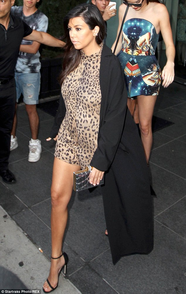 Leggy leopard: Kourtney Kardashian showed a lot of skin in her racy animal print dress as she joined her reality star family out and about in New York City on Thursday