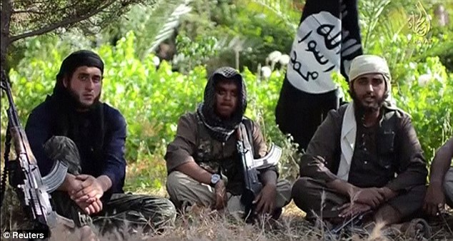 Extremists: Young British jihadis Khan, centre, and Muthana, right, appeared in an Isis recruitment video