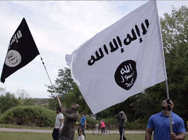 Extreme: The barbecue was bedecked with banners (pictured) featuring the logo of Isis