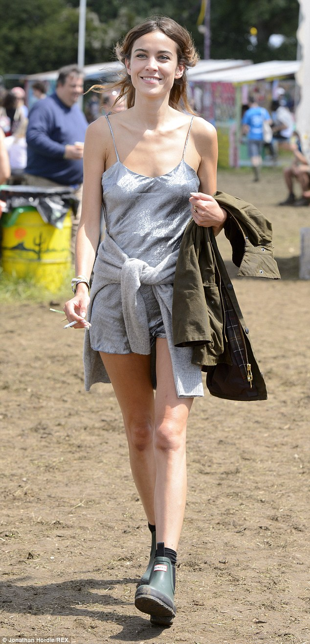 It girl: Alexa Chung wears silver space-age short jumpsuit at Glastonbury on Sunday