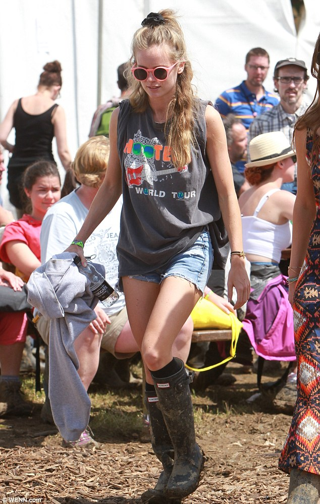 Festival girl: Cressida looked cool wearing a pair of denim shorts and a Hooters T-shirt