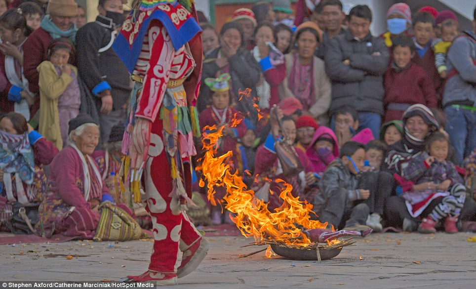 Expelling evil spirits: Skeleton men burn the Zor (an effigy) at the end of their performance