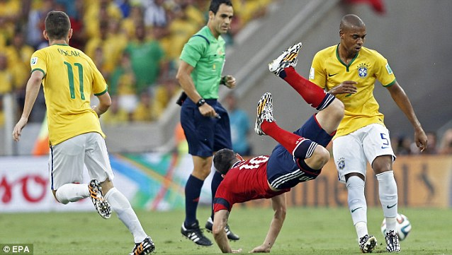 Where's the ball? Fernandinho clatters into James Rodriguez in the first half of the match in Fortaleza