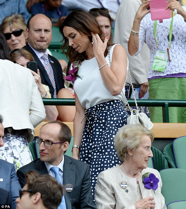 Stylish: Christine looked glamorous as she settled into her seat