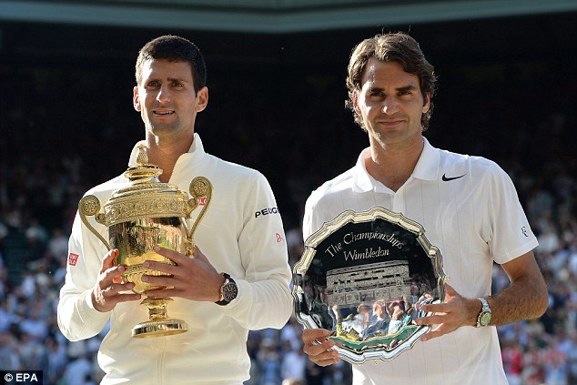 So close: Federer poses with his runner-up trophy alongside Djokovic after just losing out to his younger rival