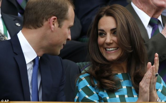 Excited: Prince William and Kate, Duchess of Cambridge talk prior to the men's singles final between Roger Federer of Switzerland and Novak Djokovic of Serbia at Wimbledon