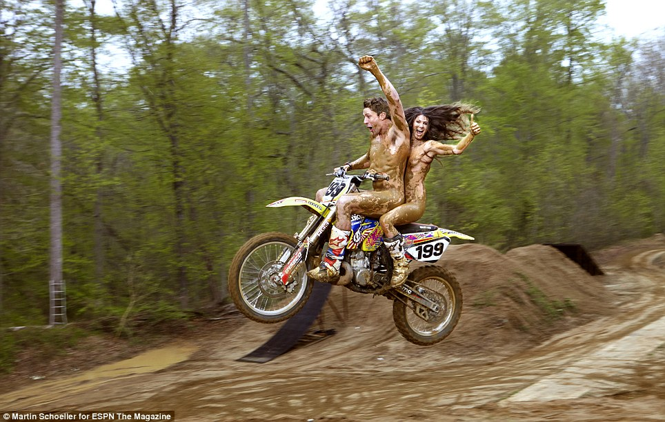 Having a blast: X-Games motor sports legend Travis Pastrana and his skateboarder wife Lyn-Z Pastrana get a little muddy during their photoshoot (pictured)