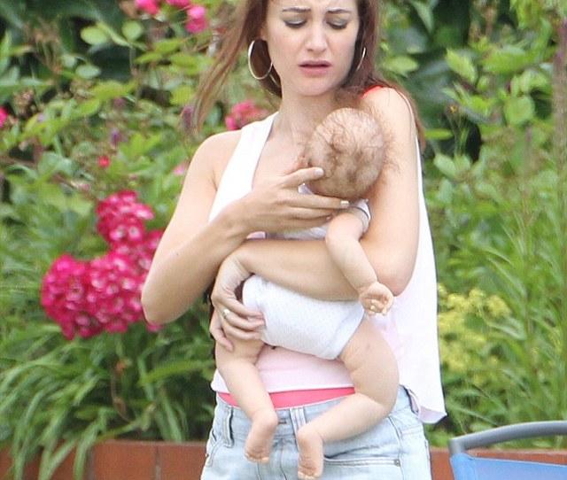 Worried Paula Looks A Bit Unsure Of Herself As She Cradles The Lifelike Baby Doll