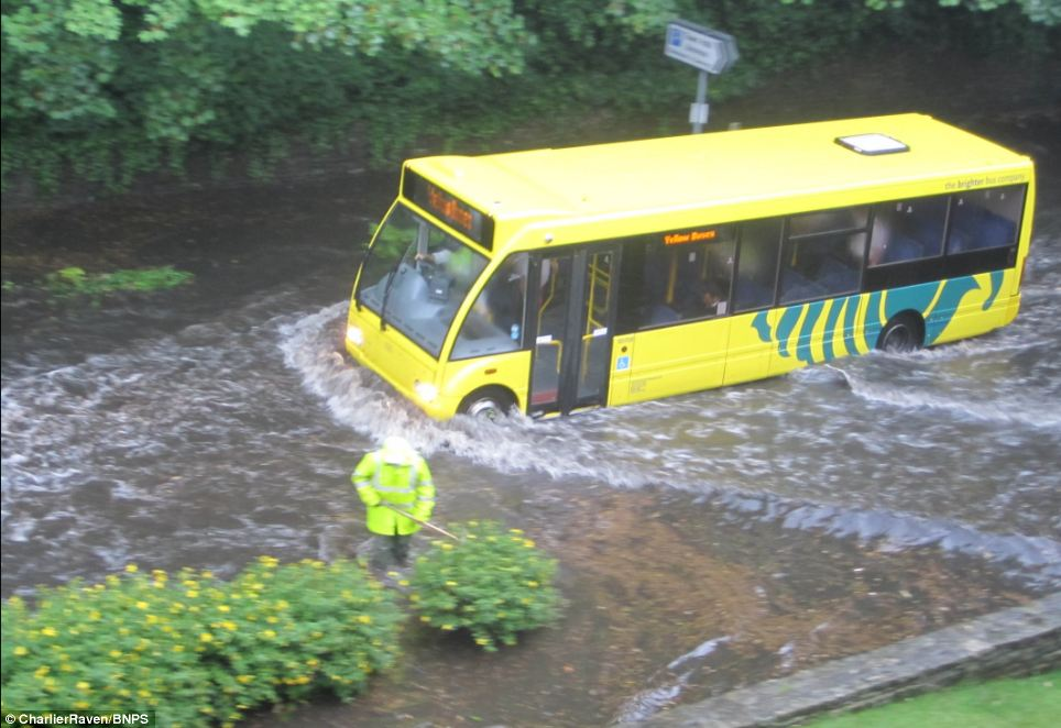 Flash flooding affected many parts of the country today after a series of short, heavy downpours. This bus in Braidley Road in Bournemouth struggled through the flooding