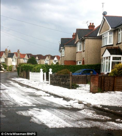 A street in the Branksome area of Poole in Dorset looked like a scene from winter after hail fell today