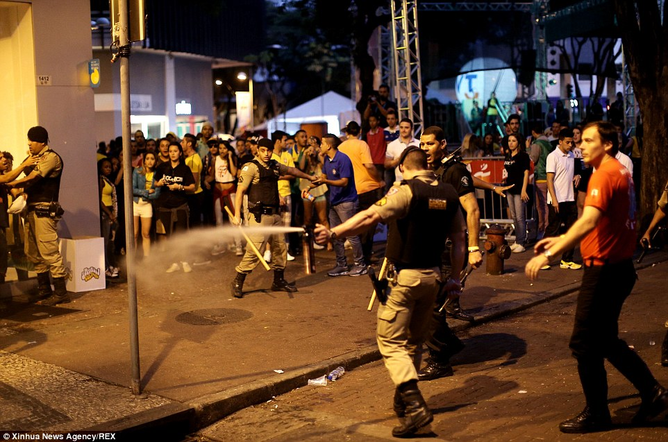 Mandatory Credit: Photo by Xinhua News Agency/REX (3898819a)  Police officers take actions to keep order after a semifinal match between Brazil and Germany ended with the 7-1 defeat of Brazil  Unrest in Belo Horizonte, Brazil - 08 Jul 2014  Germany beat Brazil 7-1