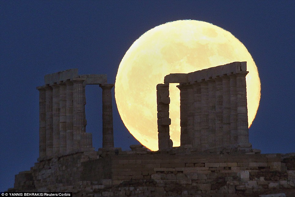 A supermoon rises over the temple of Poseidon, the ancient Greek god of the seas, in Cape Sounion some 60 km (37 miles) east of Athens June 23, 2013. On Saturday a perigee moon coincides with a full moon creating a super moon when it will pass by the earth at its closest point