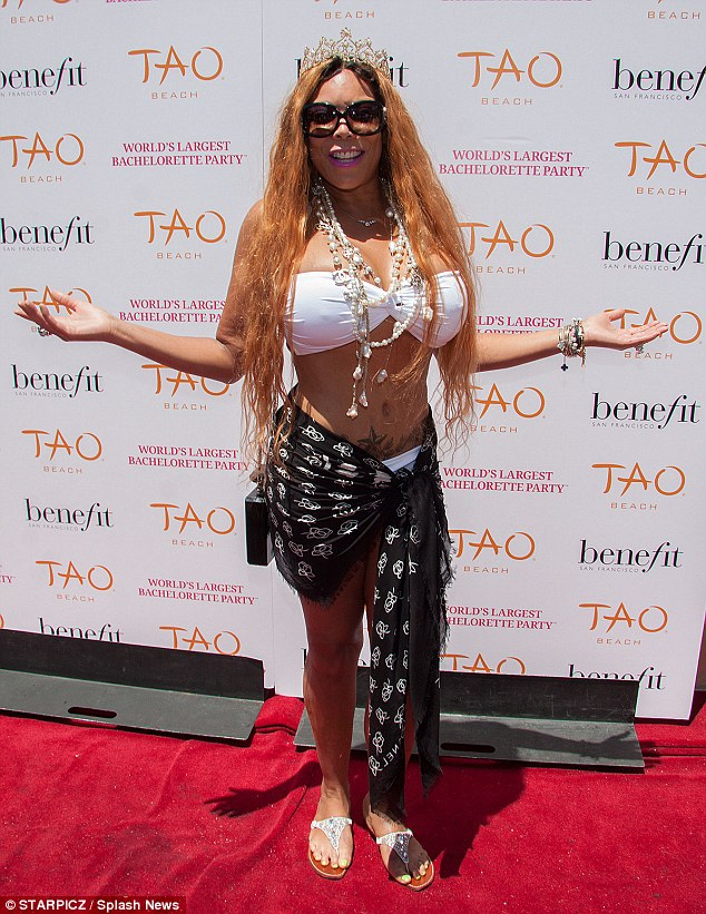 Svelte: Wendy Williams put her surgically enhanced figure on display in a white bikini at The Venetian's TAO Beach on Saturday