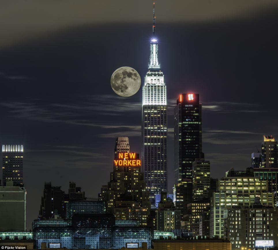 Supermoon over New York: For reasons not fully understood by astronomers or psychologists, low-hanging Moons look unnaturally large when they beam through trees, buildings and other foreground objects.