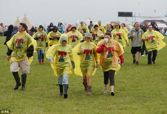 Emergency ponchos at the ready: the crowd stay warm as the day's entertainment heats up on stage