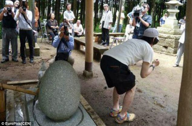 A visitor completes the 'holy egg' ritual, which follows a special prayer and a bathing service in a local river