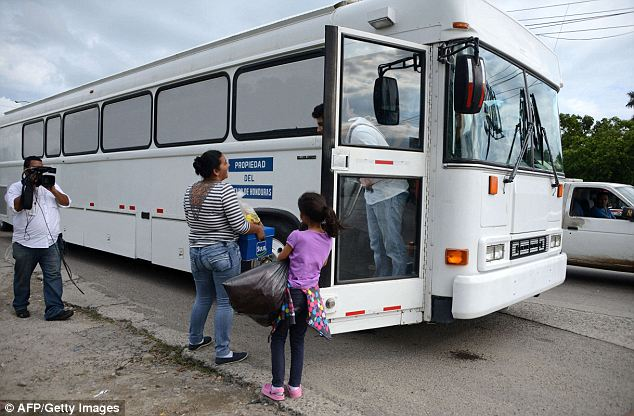 Unhappy return: A bus was set to take the wary travelers back to the homes they so desperately wanted to leave