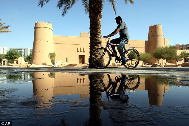 A Saudi man rides his bike in Riyadh, Saudi Arabia, where anyone caught drink-driving faces 800 lashes