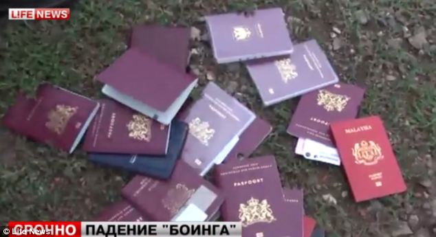 Russian news footage taken from the crash site shows passports on the ground among the wreckage of MH17
