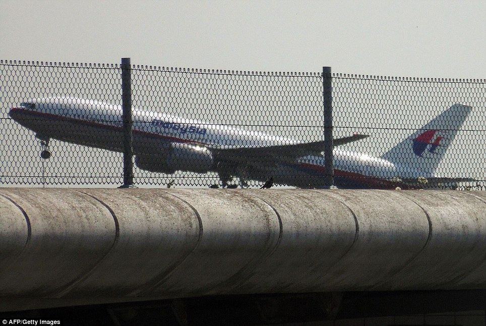 Doomed: Flight MH17 takes off from Schiphol Airport in Amsterdam hours before it was shot down over Ukraine
