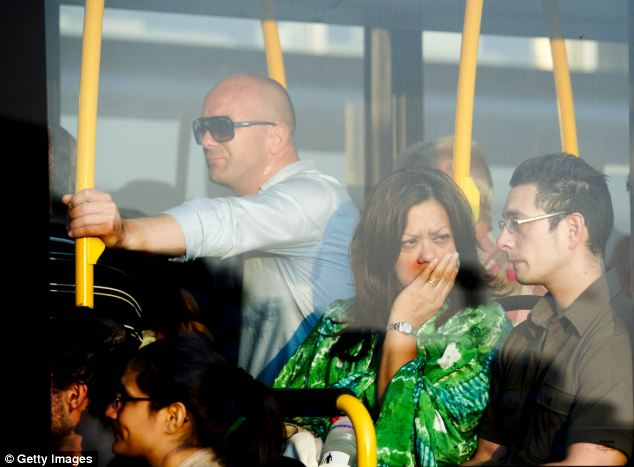 Tearful family members leave Schiphol airport in a bus provided after finding out the fate of their relatives. The crash site was littered with remains of charred passports