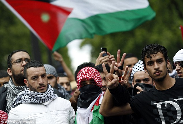 Pro-Palestinian demonstrators take to the streets of Paris on Sunday. France's socialist government has sparked uproar after it banned protests against Israeli action in Palestine