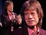 Mick Jagger casts a purple haze in lavender suit as he attends screening of James Brown biopic Get On Up