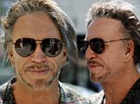 New hairdo: Mickey Rourke sported a new hair style on Thursday while out and about in Beverly Hills, California