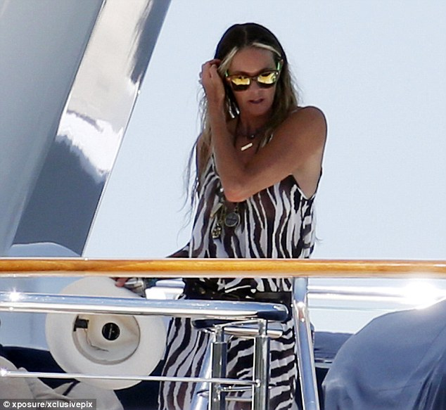 Animal instinct: The star later put on a zebra print kaftan to protect her body from the rays
