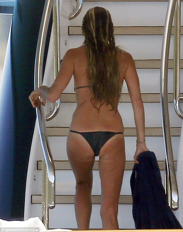 Pert posterior: Elle's change of bikini was equally as good at showcasing her incredible figure and tan lines