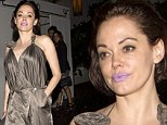 Rose McGowan cuts a pale figure with purple lips as she finishes a fancy evening at the Chateau Marmont
