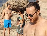 Gettin' Over You: David Guetta takes a beach break with his two children and a mystery brunette in Ibiza