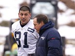Before it all unraveled: Aaron Hernandez (left) walking with New England Patriots head coach Bill Belichick during a 2012 practice